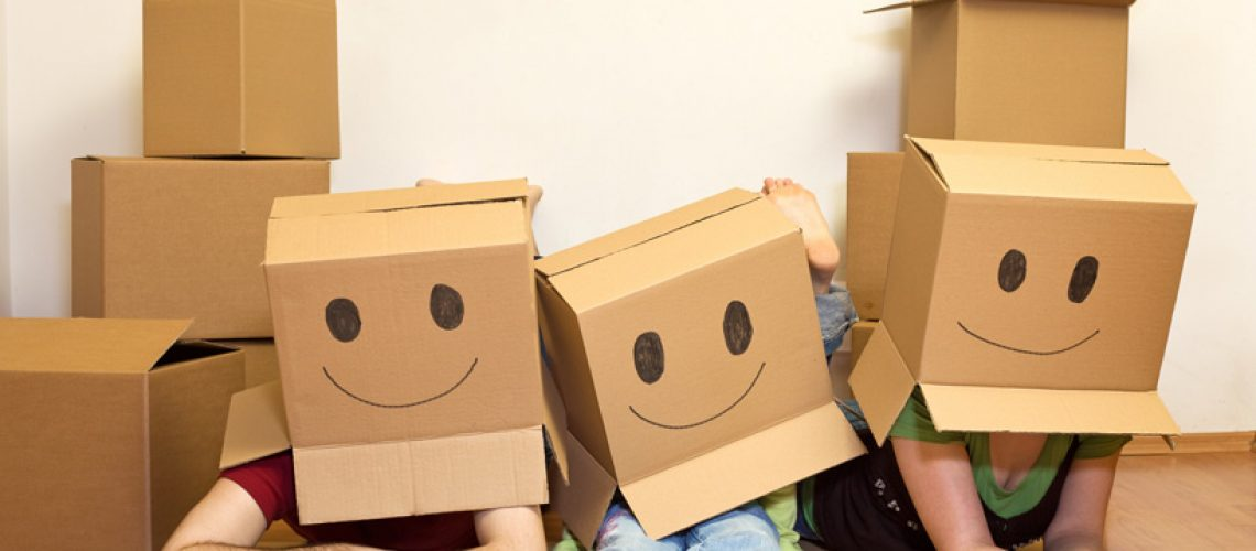 family wears boxes on their heads